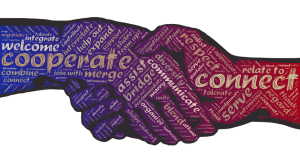 handshake with superimposed words--all of which relate to collaboration