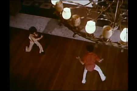 High angle shot. Two figures fighting, viewed from above.